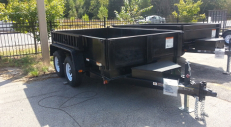 6x10 deckover dump trailer on our lot