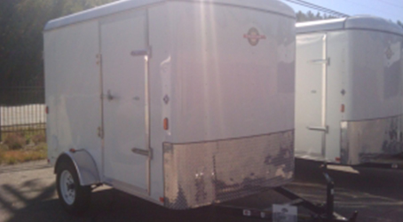 White 5x8 trailer on our lot